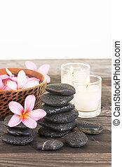 fleurs, pierres, bougie flottante