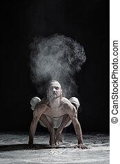 flexível, homem ioga, fazendo, mão, equilíbrio, asana,...
