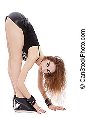 Flexibility - Young beautiful slim girl in sexy leather...