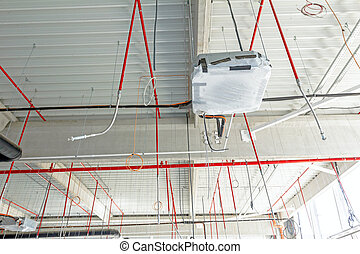 Flexible air conditioning and fire fighting system is placed on the ceiling