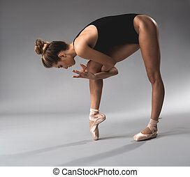 Flexible ballerina training her technical skill