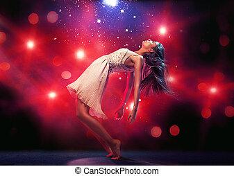 Flexible ballet dancer on the dance floor