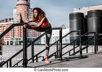 Beautiful skinny young woman developing her flexibility