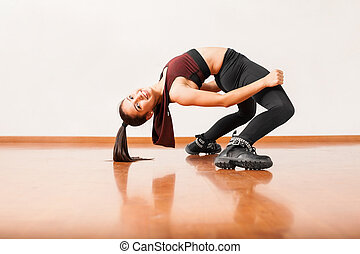 Flexible dancer bending backwards