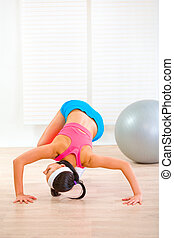 Flexible girl doing gymnastics exercise