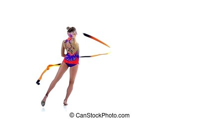 Flexible gymnast in a beautiful shiny suit with the help of a professional tape creates beautiful hands graceful movements. White background. Slow motion