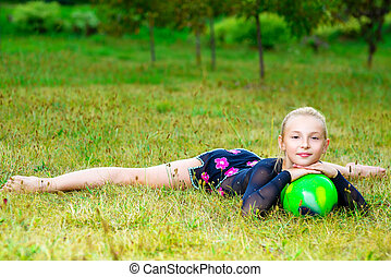 flexible little blondie girl doing gymnastics horizontal split