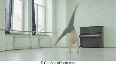 Flexible woman practicing stretching exercises - Flexible...