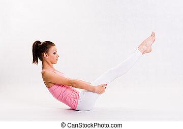 Flexible young yoga girl.
