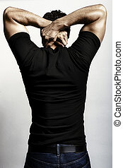 Flexing back - The back of a strong adult male flexing with ...