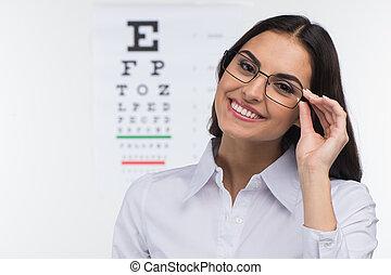 flicka, glasögon, holdingen, läkare, över, lycklig, ung, ...
