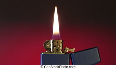 Flickering Cigarette Lighter Flame - The flickering flame of...