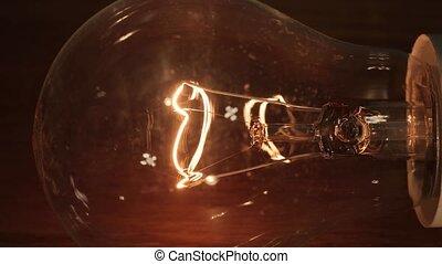 Flickering light bulb - Tungsten lightbulb flickering with...
