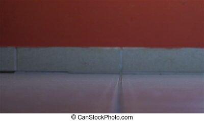 Flickering lightbulb breaking on the floor