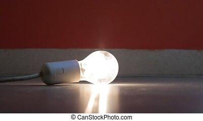 Flickering lightbulb on the floor