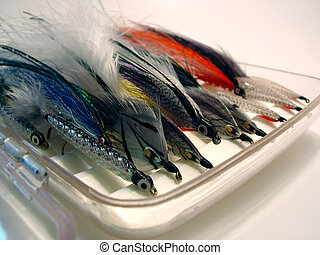 A box of hand tied flies for fly fishing.