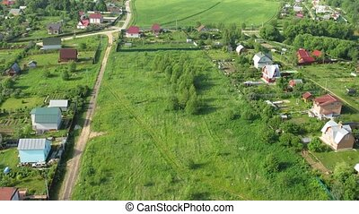 Flight above cottages near Moscow in hot air balloon, view...