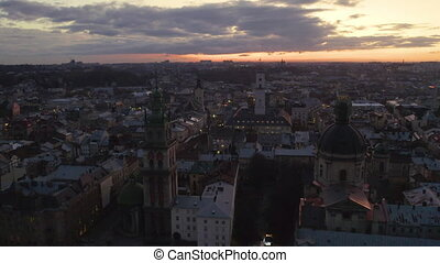 flight above the roofs on nighte. old european city. Ukraine Lviv City