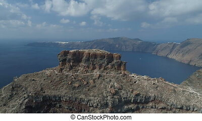 flight around the rock of Skaros in Santorini, day time