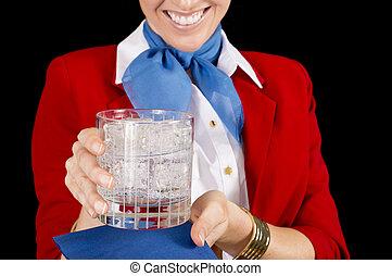 Flight Attendant Serving a Drink - An unidentifiable flight ...
