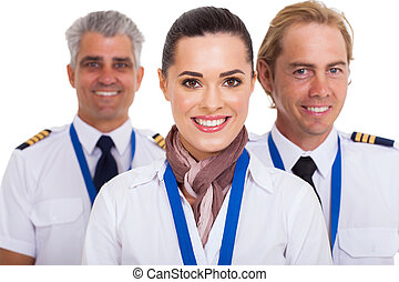 beautiful flight attendant standing in front of two pilots