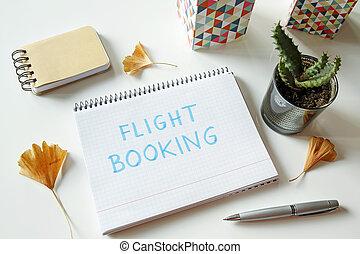 flight booking written in notebook