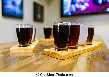 Flight craft beer glasses on wooden tray