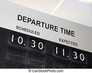information board at airport with flight delay