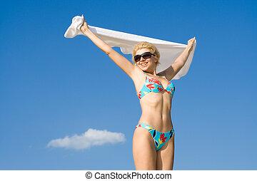 flight - happy girl relaxing on the beach