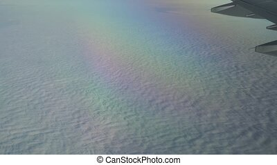 Flight high above the clouds. Porthole view, aerial video -...