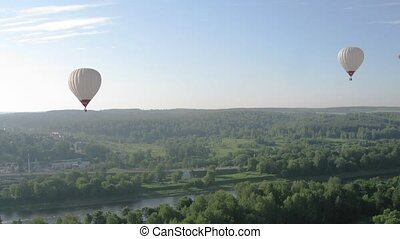 Flight in hot air balloon, view from gondola, time lapse