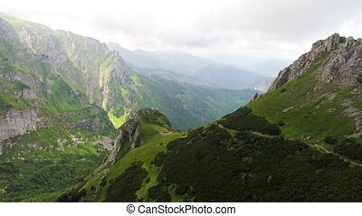 flight in mountains near Gewont peak at Poland tatry