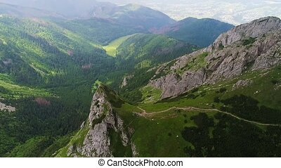 flight in mountains near Gewont peak at Poland tatry
