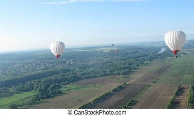 Flight in the sun in aerostat, view from basket