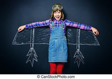 flight inspiration - Dream flight. Cheerful girl imagines ...