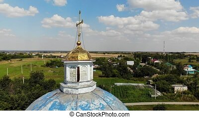 Flight near the Cross of old village church, Russia - Flight...