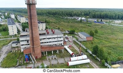 Flight of a quadrocopter around a construction site with a chimney.