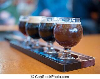 Flight of dark beers at a brewery