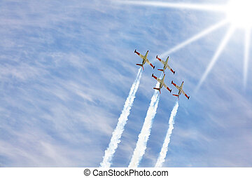 Synchronous delightful flight of four sparkling planes on air parade