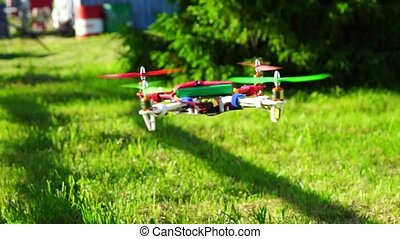 Flight of quadcopter, slow motion - Colorful quadcopter...