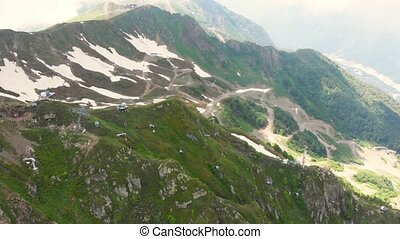 Flight of the camera over mountains. Aibga Ridge. Cable car...