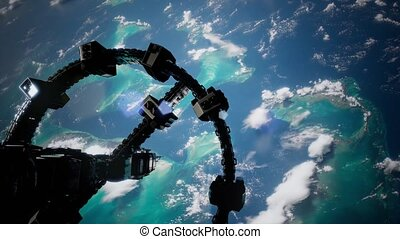 Flight Of The International Space Station Above the Earth. -...