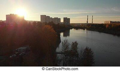 Flight On the Sunset over Shkolnoe lake in Zelenograd of Moscow, Russia