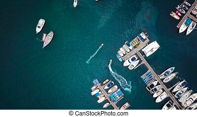 Flight over a dock with a lot of yachts and boats - shooting...