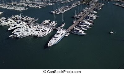 Flight over a dock with a lot of yachts and boats - shooting from a drone