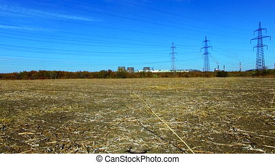 Flight over a field near a power line. Low Flight over the...