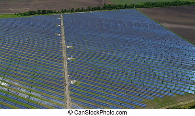 Flight over a large solar power station. Aerial survey