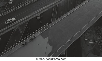 Flight over a transport multi-level interchange, at rush hour, black and white video