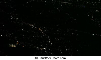 Flight over big city at night