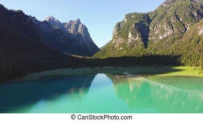flight over big mountain lake - flight over green mountain...